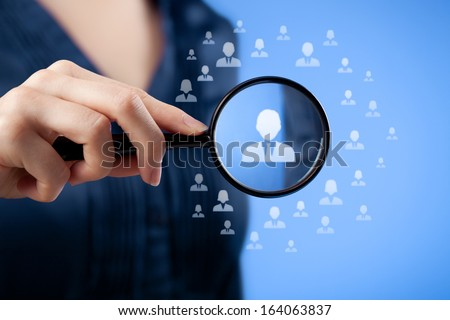 Human resources, CRM, data mining, assessment center and social media concept - woman looking for employee represented by icon. - stock photo