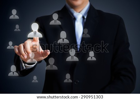 Human resources officer choose employee standing out of the crowd, Select team leader concept - stock photo