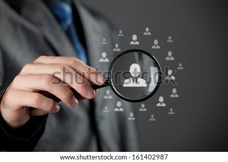 Human resources officer (HR) choose employee standing out of the crowd. Select team leader concept. - stock photo