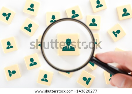 Human resources, personal audit, assessment center and sales force concept - recruiter look for employee represented by icon. - stock photo