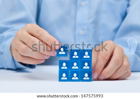 Human resources, sales force, social networking, assessment center, personal audit or CRM concept - recruiter complete team by one person. Employees are represented by blue glass cubes with icons. - stock photo