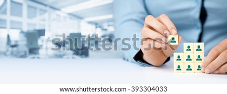Human resources, social networking and assessment center concept - recruiter complete team by one person (employee) represented by icon. Wide banner composition with office in background. - stock photo