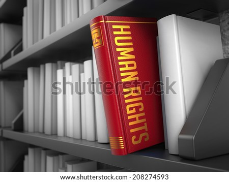 Human Rights - Book on the Black Bookshelf Between White Ones. - stock photo