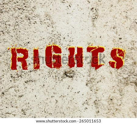 Human Rights message graffiti painted on a concrete wall  - stock photo