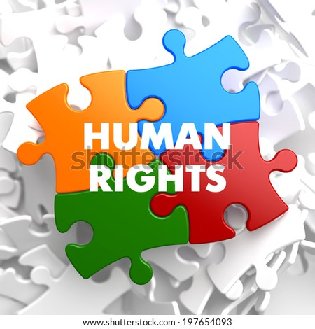 Human Rights on Multicolor Puzzle on White Background. - stock photo