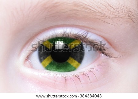 human's eye with national flag of jamaica - stock photo
