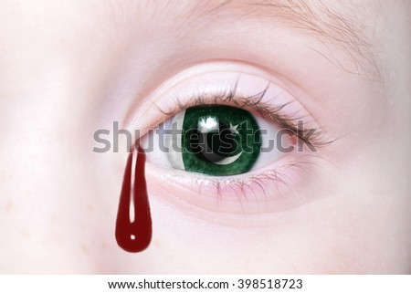 human's eye with national flag of pakistan with bloody tears. concept - stock photo