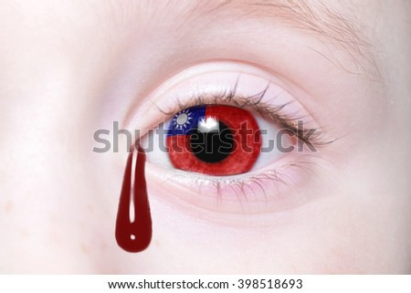 human's eye with national flag of taiwan with bloody tears. concept - stock photo