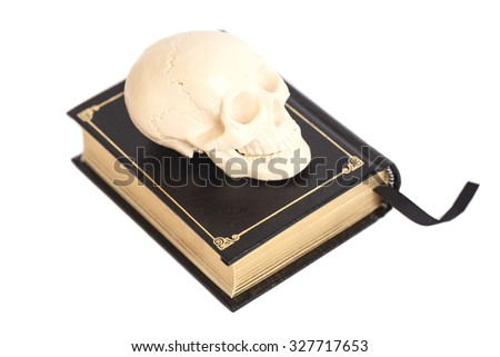 Human Scull On Book isolated on white - stock photo
