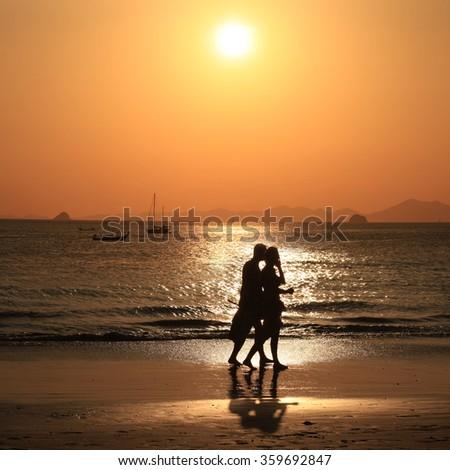 Human Silhouette Ocean Beach at Sunrise, sun reflection on sea water. Freedom, beauty - stock photo