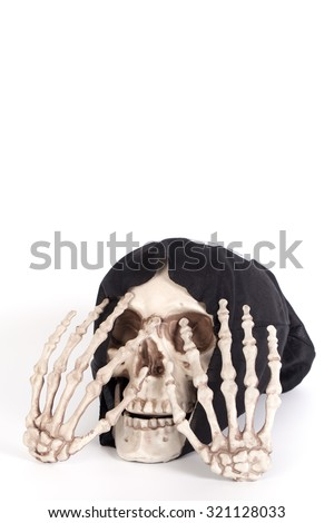 Human Skull Close your eyes with Human Hand and devil black cap isolated on white - stock photo