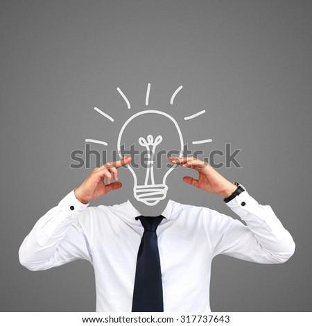 Human skull on businessman. - stock photo