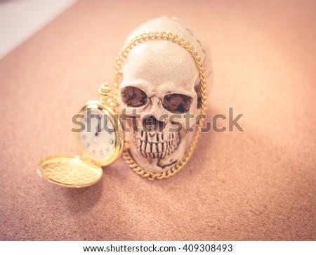 human skull with clock - stock photo