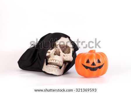 Human Skull with Devil black cap and pumpkin isolated on white - stock photo