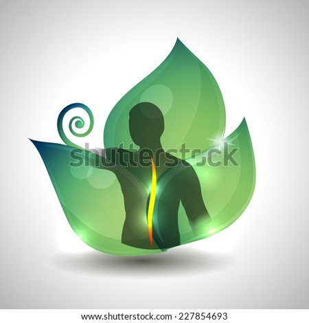 Human spine health care, Human spine silhouette and green leaf at the background. - stock photo