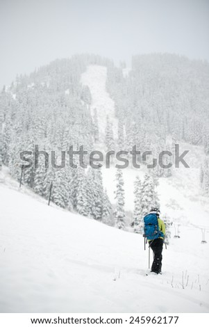 human stand front of the mountains on snow in the winter. - stock photo