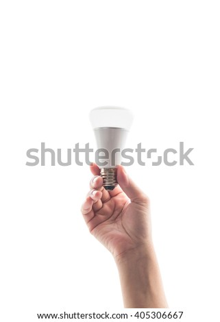 Human woman person's hand holding LED light emitting diode lightbulb energy saving bulb isolated on white background with clipping path: Saving energy by creative innovative technology design concept - stock photo
