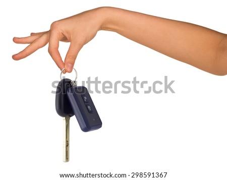 Humans hand holding car keys on isolated white background - stock photo