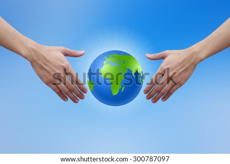 humans hands reaching the world for heal together, safe the world concept. environment concept. - stock photo