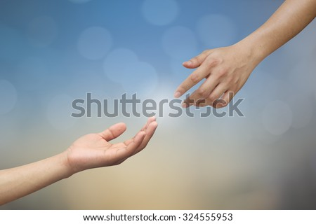humans man hand and god's hand trying to connect together:human's hand praying for forgiveness,power,rich,faith,believe or etc and god's hand trying to give blessing for all pray:religion concept. - stock photo