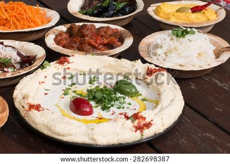 hummus, Different appetizer, anti pasti - stock photo