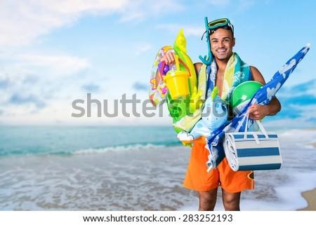 Humor, Tourist, Beach. - stock photo