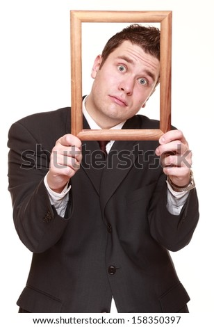 Humorous business man getting his head out of empty frame desperate imploring facial expression, isolated on white background - stock photo