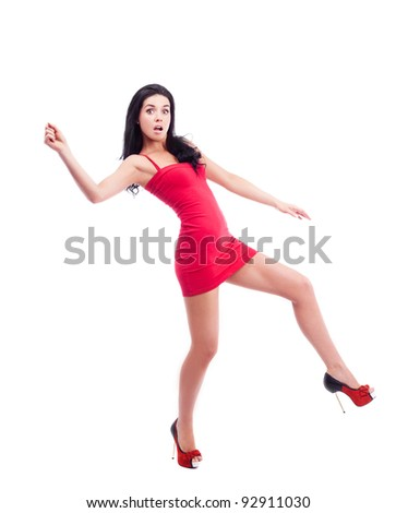 humorous portrait of a sexy young brunette woman running, isolated against white background - stock photo