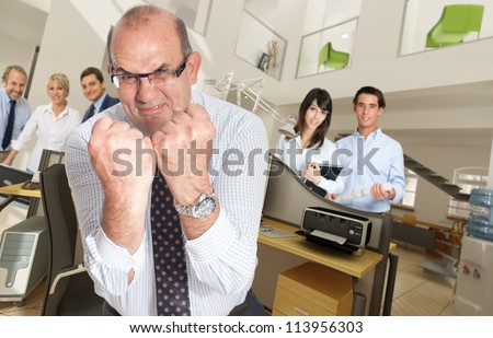 Humorous shot of a menacing business man in an office surrounded by smiling workers - stock photo