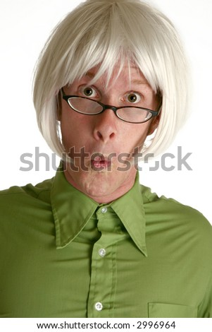 Humorous shot of thirty something man in white wig making crazy expression. - stock photo
