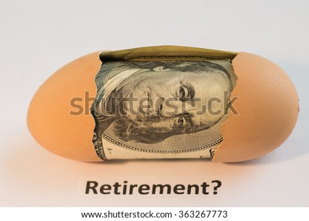 Hundred bills in a egg / Large nest egg - stock photo
