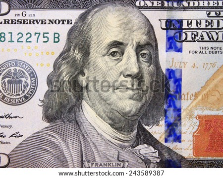 hundred dollar bank note with image of president Benjamin Franklin - stock photo