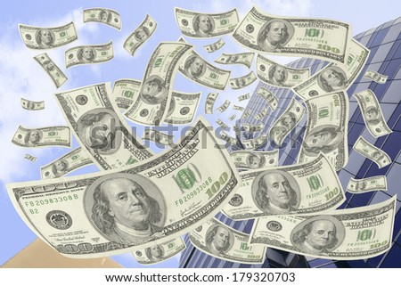 Hundred-dollar bills falling from the building. - stock photo