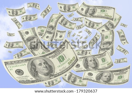 Hundred-dollar bills falling from the sky. - stock photo