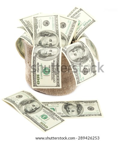 Hundred dollar bills in a canvas sack isolated on a white background. - stock photo