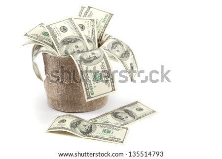 Hundred dollar bills in a canvas sack isolated on white background. - stock photo