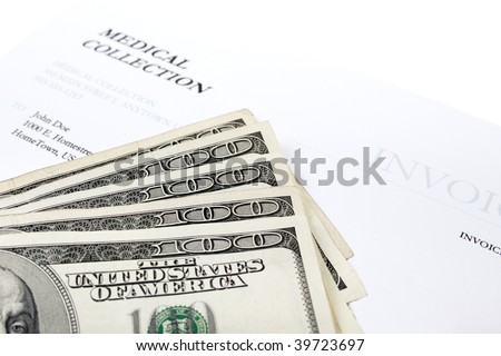 Hundred dollar bills on medical collection invoice - stock photo
