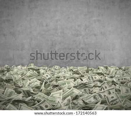 Hundred dollar notes at the ground, cement wall - stock photo