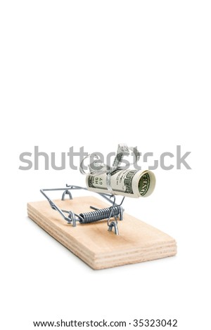 Hundred dollars bill in a mouse trap is isolated over white background - stock photo