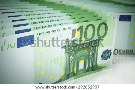 Hundred euro banknotes stacks (depth of field) - stock photo