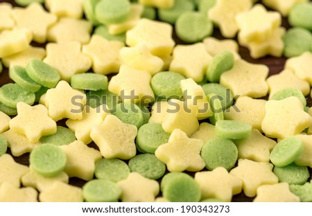Hundreds and thousands circle and stars cake sprinkles close up - stock photo