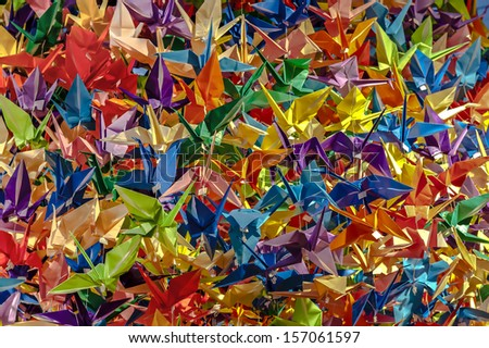 Hundreds of colorful origami paper cranes - stock photo