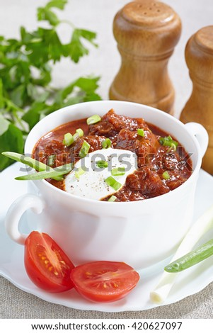 Hungarian cuisine. Goulash served in a white tureen - stock photo