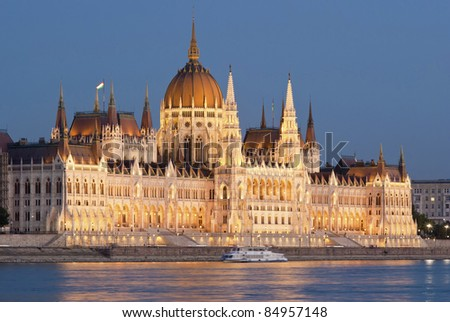 Hungarian parliament with floodlight at dusk, Budapest - stock photo