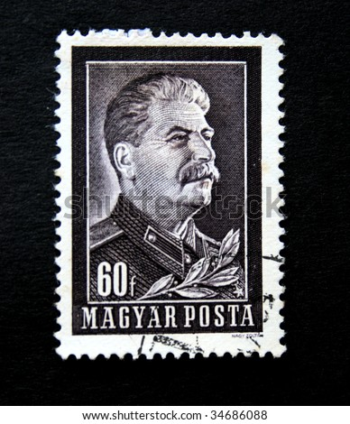 HUNGARY - CIRCA 1950: A stamp printed by Hungary shows Stalin circa 1950. - stock photo