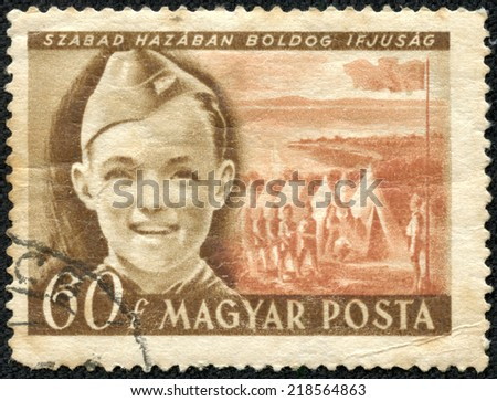 "HUNGARY - CIRCA 1950: A stamp printed in Hungary from the ""Children's Day"" issue shows Pioneer boy and camp, circa 1950. - stock photo"