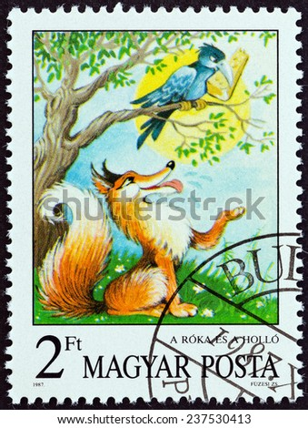 """HUNGARY - CIRCA 1987: A stamp printed in Hungary from the """"Fairy Tales """" issue shows  The Fox and the Raven (Aesop), circa 1987.  - stock photo"""