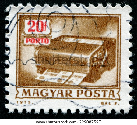 """HUNGARY - CIRCA 1973: A stamp printed in Hungary from the """"Postal Operations"""" issue shows a money-order cancelling machine, circa 1973 - stock photo"""