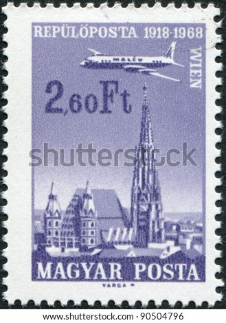 HUNGARY - CIRCA 1968: A stamp printed in Hungary, is dedicated to the 50th anniversary of airmail Budapest-Vienna, depicts St. Stephen's Cathedral, Vienna, circa 1968 - stock photo