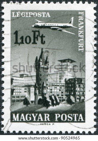 HUNGARY - CIRCA 1966: A stamp printed in Hungary, is depicted in Frankfurt am Main, aircraft, Eschenheimer Turm and Eschenheimer Gate, circa 1966 - stock photo